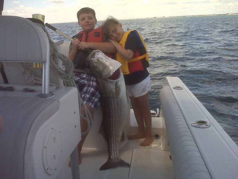 """Date – Fri  7/2/10<br />  <br /> Ocean West of Tobay<br />   <br /> My kids Sean 11 and Ava 7 wanted to get in on the Big Bass action. Conditions were a little tough with a little wind and no real hot pods. All the time I spent fishing with Capt. Al through the years paid off as I found one that I could tell was holding fish and we worked it real hard before we pulled a fish. The kids did great and worked together as a team reeling in the fish. The line of the day was –""""Dad somethings wrong with the reel –it won't crank""""; Final tally was Two Fish –one was a little over 40 lbs and the other was right around 30 lbs.<br />  <br /> John Dall"""