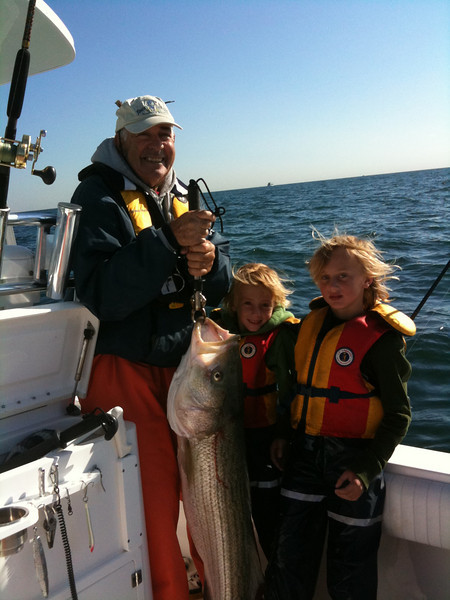 Grampa Reilly , Colin and Parker Reilly catching a nice 35lb bass jigging off fire island
