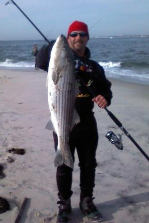11-21-2009<br /> <br /> Joe Pagillo with a nice bass caught from the beach at demo.