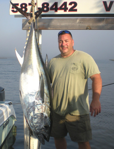 10-4-2009<br /> <br /> Fisherman James Jurs with a  beautiful Bluefin Tuna caught in the area of the Bacardi on Sunday October 4th. The fish was weighed in at Frank and Dicks and tipped the scale at 117 pounds.