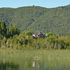Rio Manso Lodge from Hess Lake.<br /> Our room was the one on the upper left with white exterior walls and a large window.