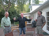 Jim Thomas, Kevin Murphy, and Peter Warren discuss the day's fishing, Owen River Lodge.