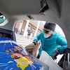 BEN GARVER — THE BERKSHIRE EAGLE<br /> Judy Condron packs a food delivery into her car at the Dalton CRA. Tuesday, May 5, 2020. The Dalton CRA distributed food collected from a no contact food drive to three food pantries (St. Agnes, Lonesome Fishes in the Dalton Methodist Church and the First Congregational Church of Hinsdale.) The three food pantries feed about 350 people combined.   The food drive, named fishing for food, took place in place of a fishing derby postponed until September due to COVID-19. The drive also raised over $700 for the pantries to use to purchase food to round out their offerings.