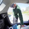 BEN GARVER — THE BERKSHIRE EAGLE<br /> Dan McMahon packs a food delivery into a car at the Dalton CRA. Tuesday, May 5, 2020. The Dalton CRA distributed food collected from a no contact food drive to three food pantries (St. Agnes, Lonesome Fishes in the Dalton Methodist Church and the First Congregational Church of Hinsdale.) The three food pantries feed about 350 people combined.   The food drive, named fishing for food, took place in place of a fishing derby postponed until September due to COVID-19. The drive also raised over $700 for the pantries to use to purchase food to round out their offerings.