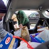 BEN GARVER — THE BERKSHIRE EAGLE<br /> Tom Condron and Dan McMahon pack a food delivery into a car at the Dalton CRA. Tuesday, May 5, 2020. The Dalton CRA distributed food collected from a no contact food drive to three food pantries (St. Agnes, Lonesome Fishes in the Dalton Methodist Church and the First Congregational Church of Hinsdale.) The three food pantries feed about 350 people combined.   The food drive, named fishing for food, took place in place of a fishing derby postponed until September due to COVID-19.