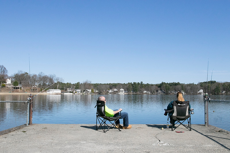Bob Paquette and Tami Arguelles of Fitchburg took some time to do a little fishing at Lake Whalom on Thursday afternoon, March 26, 2020. SENTINEL & ENTERPRISE/JOHN LOVE