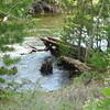 2017-07-22  Water is so high that the picnic table is in the creek (big log is undder it)