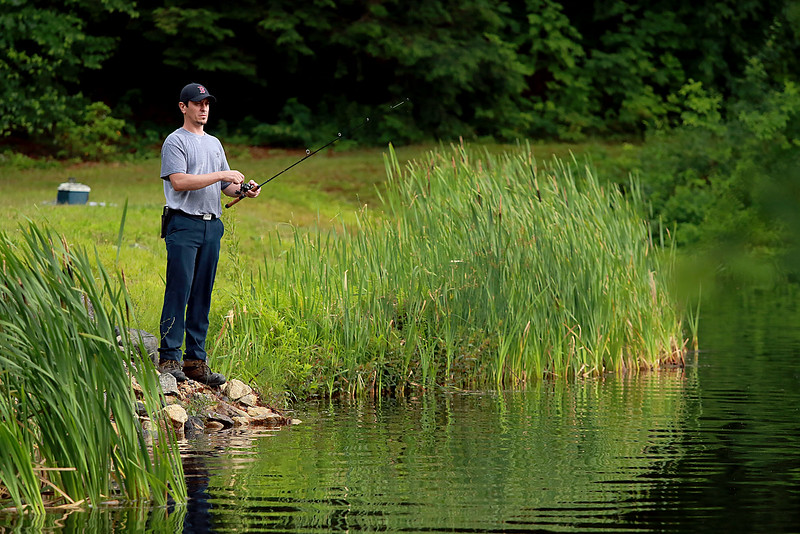 The rain did not stop Dario Barreiro of Fitchburg from taking some time late in the day to do some fishing at Round Meadow Pond in Westminster. SENTINEL & ENTERPRISE/JOHN LOVE
