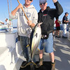 Yours truly with first yellowfin tuna of the trip.  Forgive the water spot on the lens.