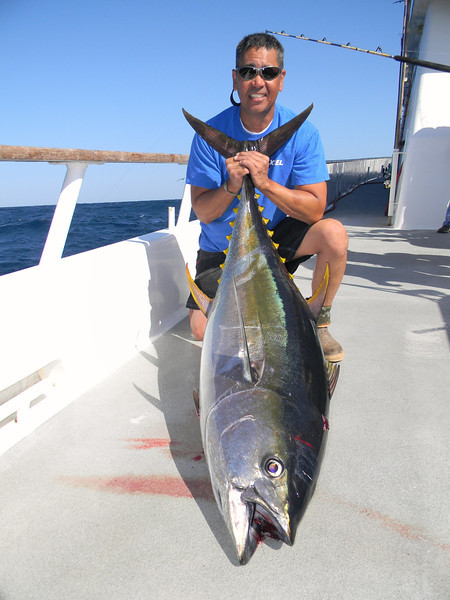 "Ron Moy with one of his ""smaller"" tuna."