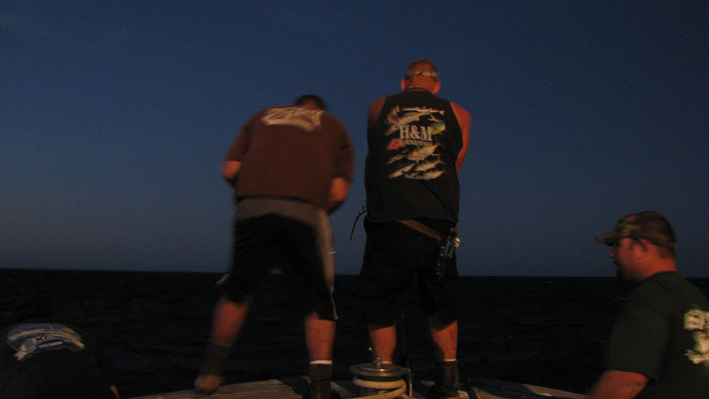Jason and Jake untangling Jeanne's and another tuna on the bow, at the anchor rope!