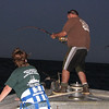 Jason working Jeanne's fish around the anchor rope for the umpteenth time.