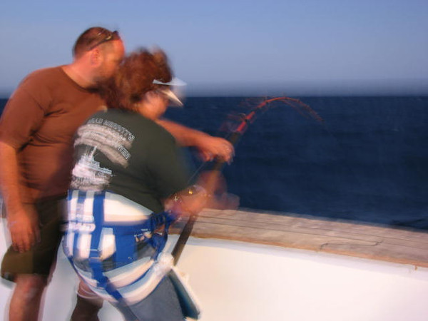 Action shot of Jeanne fighting her Tuna w/Jason lending a hand.