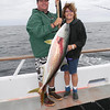 Jeanne w/nice yellowtail.  Skipper Justin Fleck does the gaffing duties.