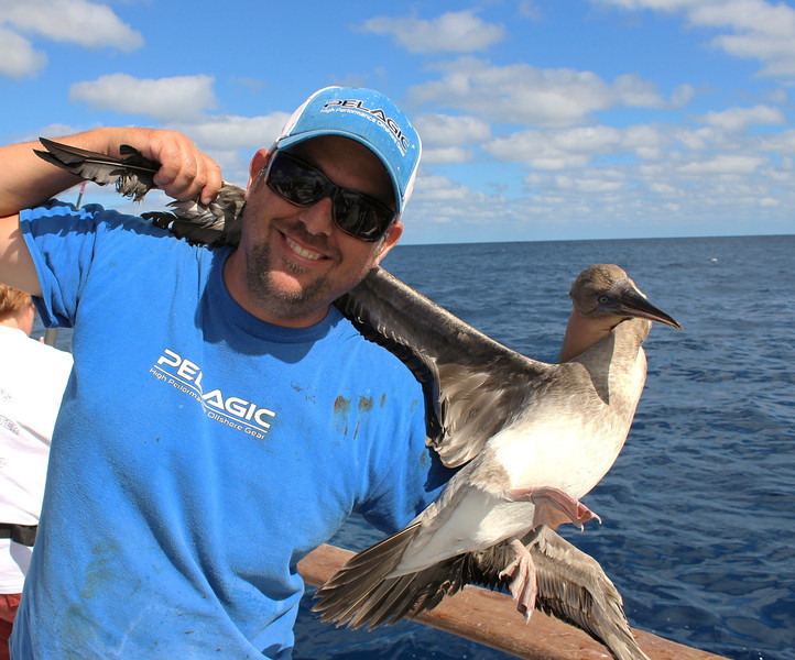 Joel posing with one of the numerous birds hooked while stealing our baits.