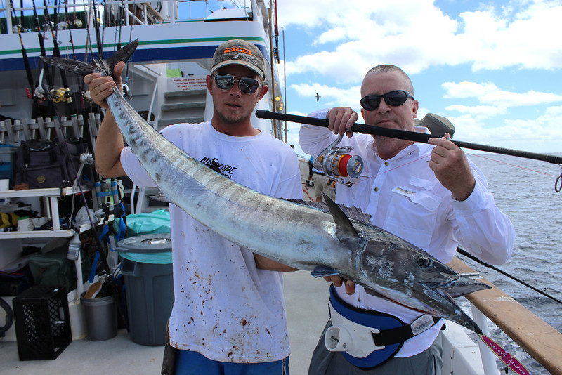 Roy Todd and Brandon with Roy's spinning reel caught wahoo
