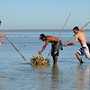Nick and Jacko being shown how to fish the traditional way by Albert on the Montgomery reef at low tide.