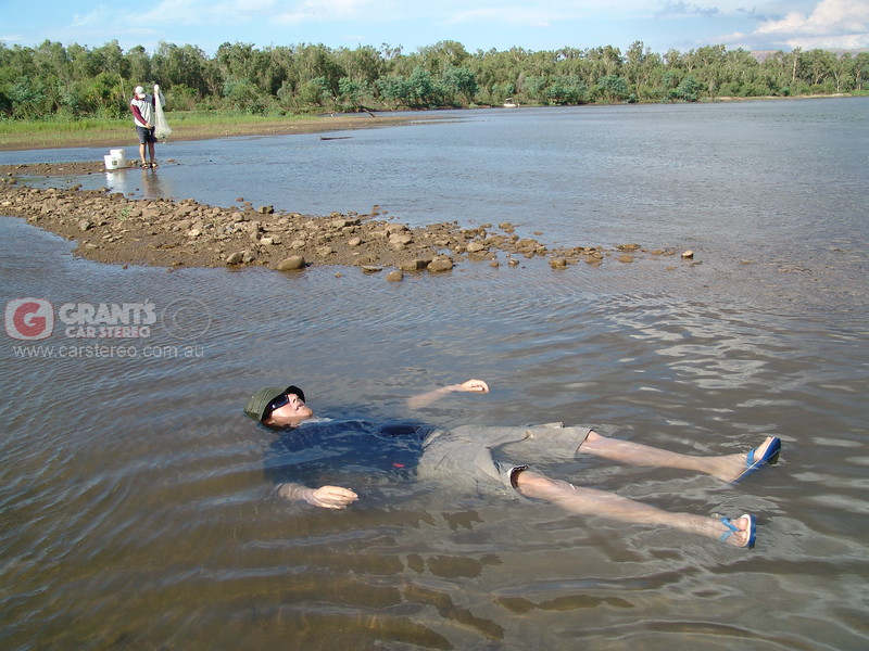 Getting relief from the 46 degree Celsius day on the Ord River Kununurra. Finding a spot with no crocodiles wasn't easy.