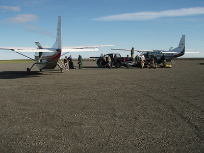 Quinhagak landing strip and the Duncan's crew loading guests and gear
