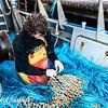 Mending the nets. Netten boeten.