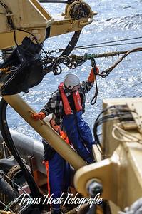 The net is in the sea. / Het net is in zee.