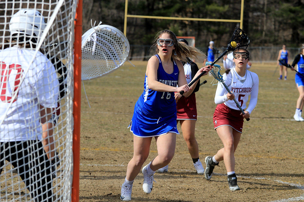 . Leominster High School girls lacrosse visited Fitchburg on Thursday to play Fitchburg High School. LHS\'s Emily Ayles winds up for a shot on FHS\'s goalie Carine Poladian. SENTINEL & ENTERPRISE/JOHN LOVE