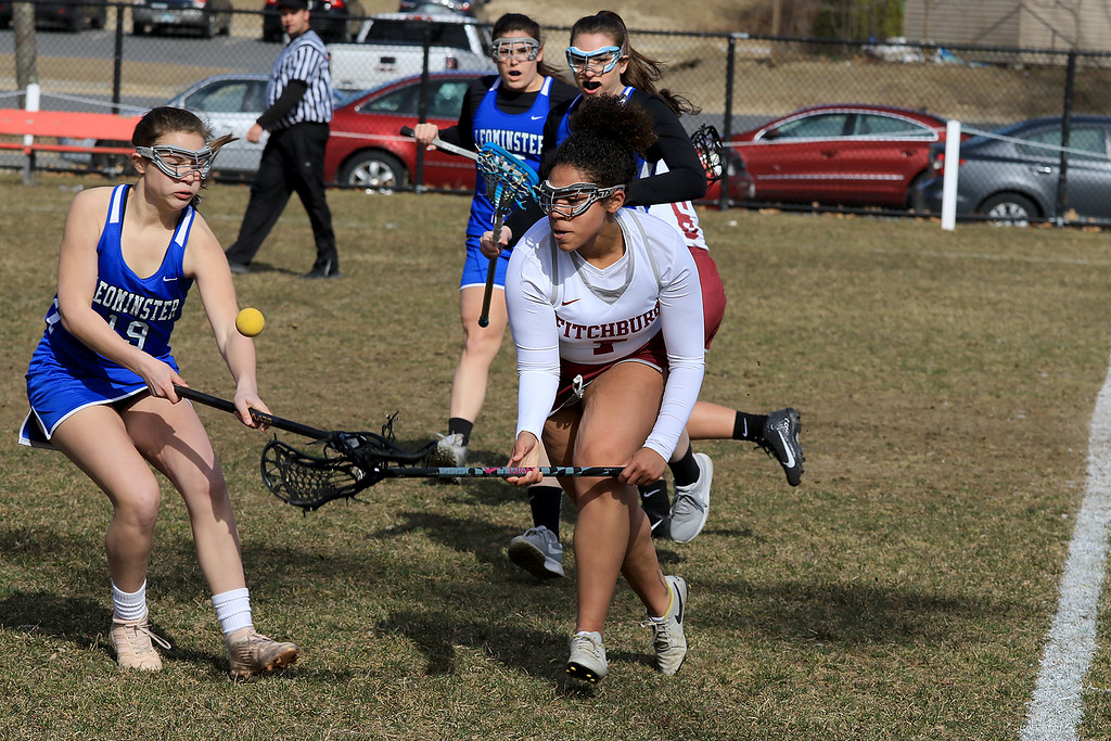 . Leominster High School girls lacrosse visited Fitchburg on Thursday to play Fitchburg High School. LHS\'s Laura Young tries to stop FHS\'s Jayda Kolaco from getting control of the ball. SENTINEL & ENTERPRISE/JOHN LOVE