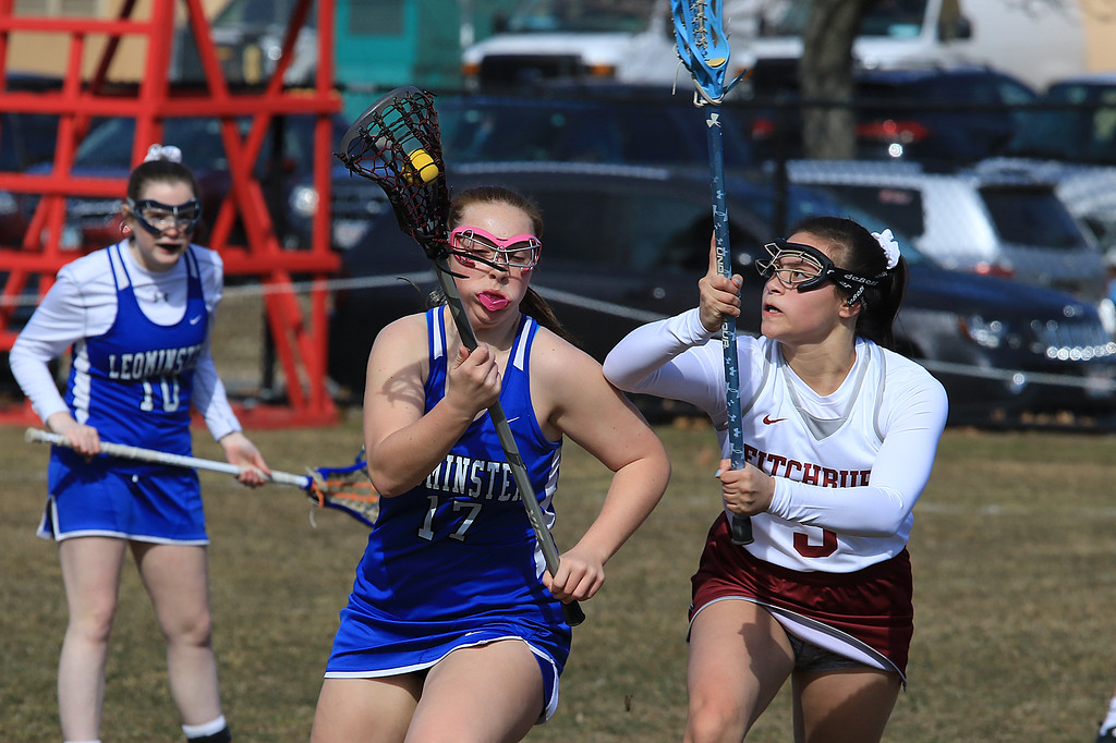. Leominster High School girls lacrosse visited Fitchburg on Thursday to play Fitchburg High School. LHS\'s Abigail Arena takes off with the bal followed by FHS\'s Jesmary Melendes. SENTINEL & ENTERPRISE/JOHN LOVE