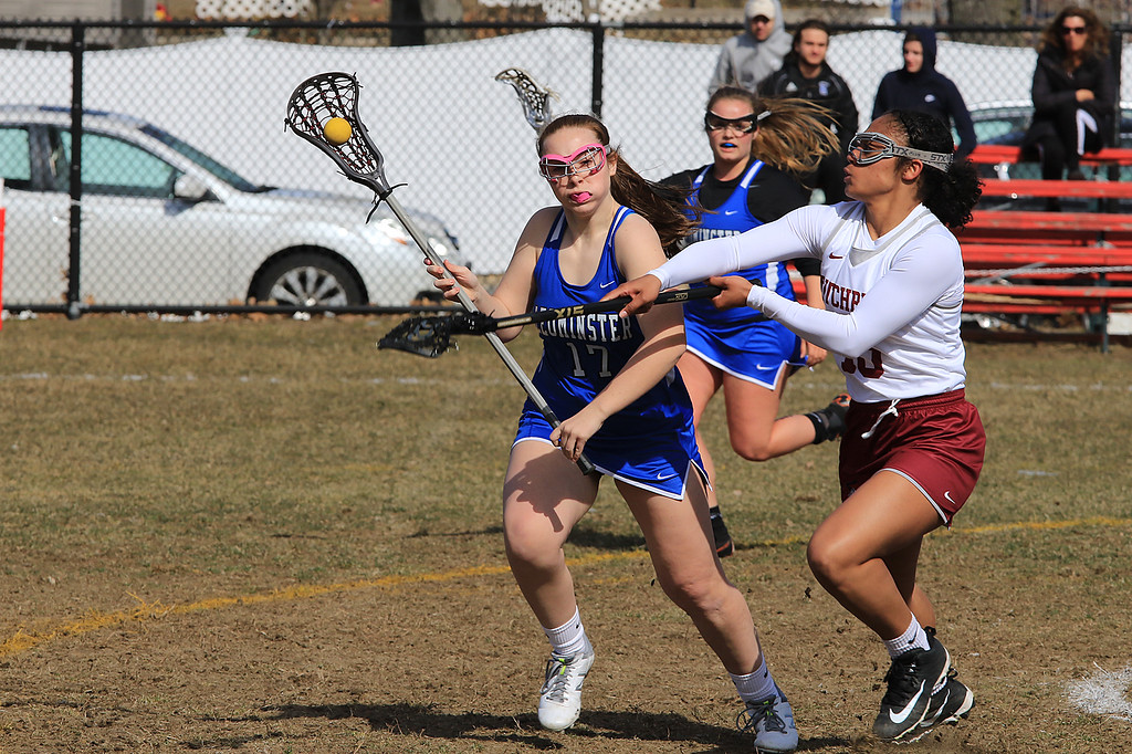 . Leominster High School girls lacrosse visited Fitchburg on Thursday to play Fitchburg High School. FHS\'s Diandra Bodie tries to get the ball from LHS\'s Abigail Arena during action in the game. Leominster earned a 12-2 victory. SENTINEL & ENTERPRISE/JOHN LOVE