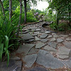 A stone path in the garden of Dr. Steven Manalan's house in Fitchburg. His garden will be one of the houses on the garden tour Saturday, June 23, 2018. SENTIENL & ENTERPRISE/JOHN LOVE