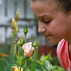 Mia Curtis, 9, check out a rose in the garden of Dr. Steven Manalan's house in Fitchburg. His garden will be one of the houses on the garden tour Saturday, June 23, 2018. SENTIENL & ENTERPRISE/JOHN LOVE