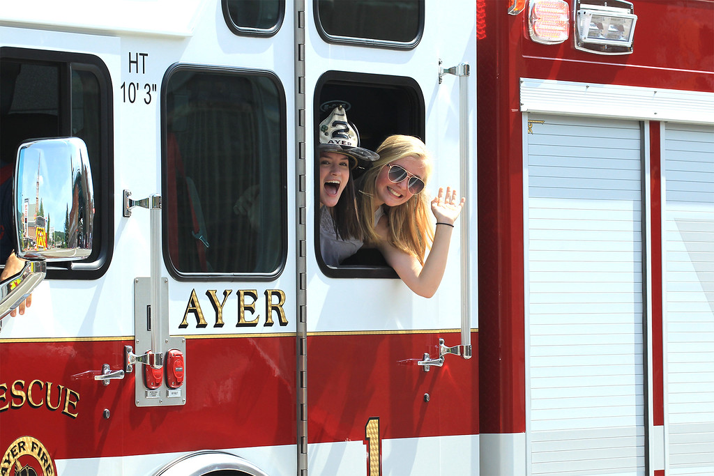 . Kaitlyn Shea daughter of Lt. Tim Shea Ayer Fire and Olivia Boucher ride on the Rescue truck  SENTINEL&ENTERPRISE/Scott LaPrade