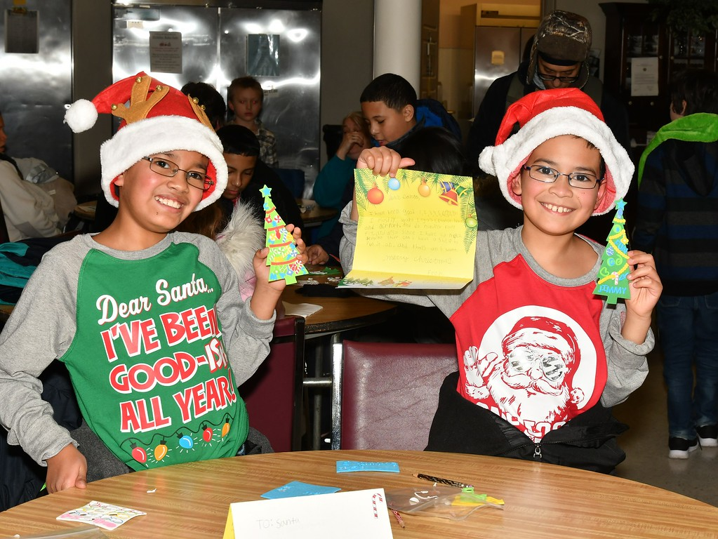 . Izaiah and Jimmy Goyco made Christmas Tree Ornaments and wrote letters to Santa. Sentinel & Enterprise / Jim Fay