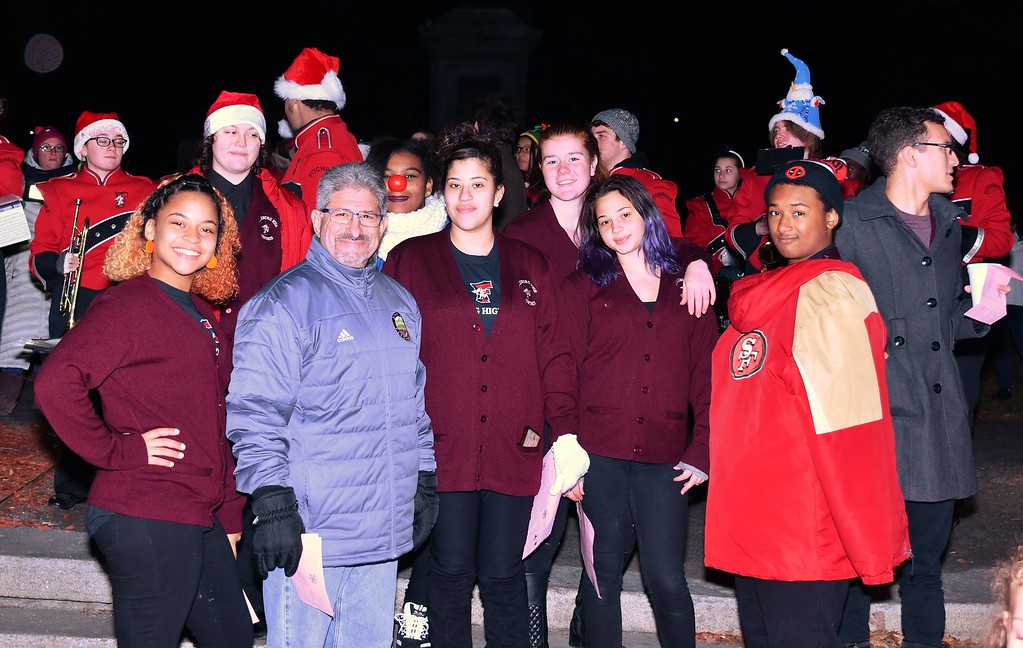 . Mayor Stephen DiNatale with members of the Fitchburg High Choir. Sentinel & Enterprise / Jim Fay