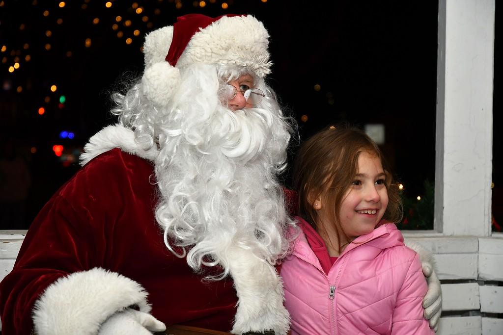 . Santa makes a new friend. Sentinel & Enterprise / Jim Fay