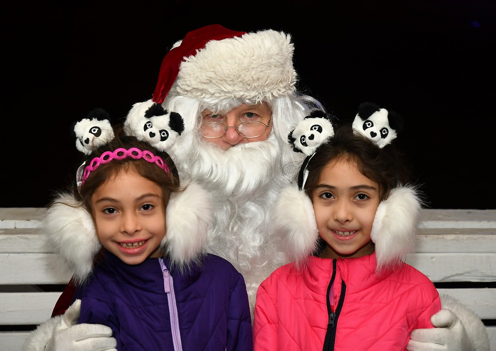 . Stephania and Victoria Sandrelli with Santa Claus. Sentinel & Enterprise / Jim Fay