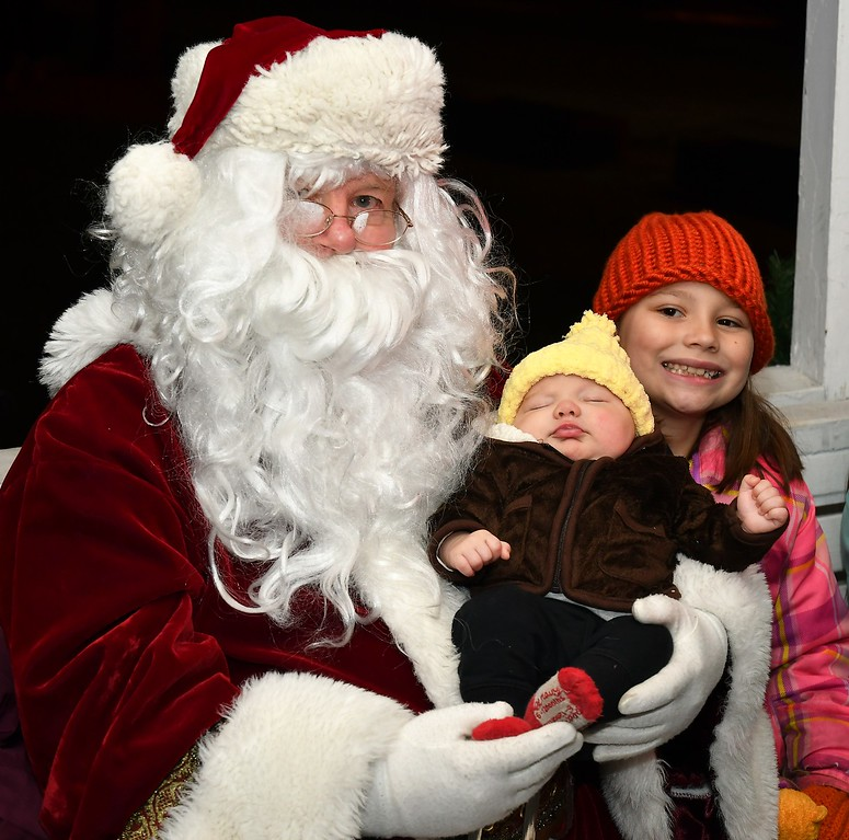. Maiya Tellier is all smiles, while 8 week old brother, Declan Tellier  doesn\'t seem all that impressed with Santa Claus. Sentenil & Enterprise / Jim Fay