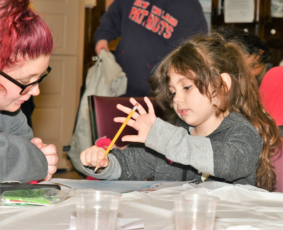 . Caitlyn Brown helps Alyce Brown (5) with a letter to Santa. Sentinel & Enterprise / Jim Fay