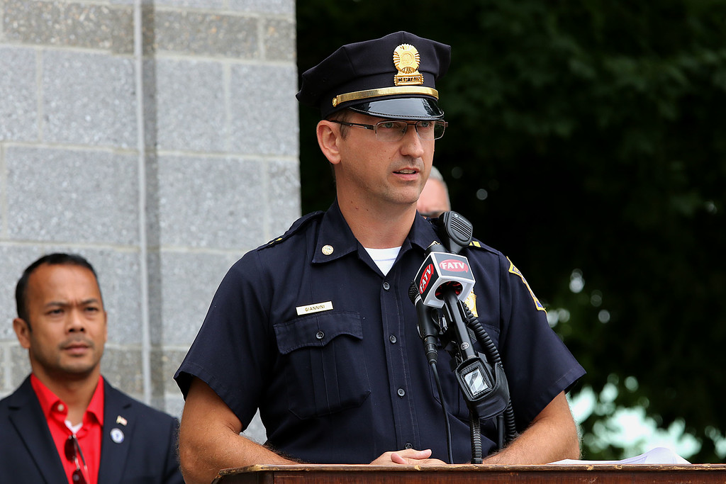 . Fitchburg Police Captain Steven Giannini addresses the crowd at the 9-11 ceremony held at the North Street station house Tuesday, September 11, 2018. Just behind him is State Senator Dean Tran. SENTINEL & ENTERPRISE/JOHN LOVE