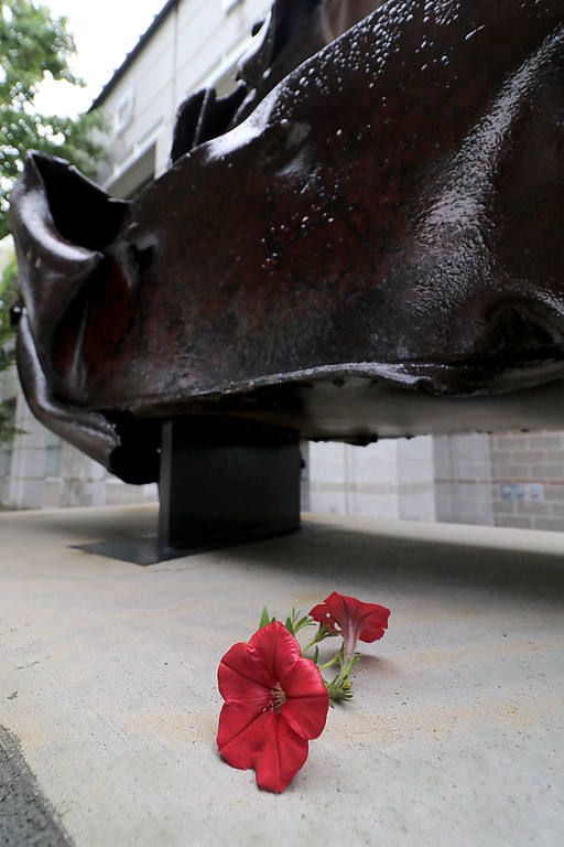 . Just before the start of the 9-11 ceremony at the North Street Fire Station in Fitchburg a man walked by and left these two flowers on the new 9-11 monument at the station. SENTINEL & ENTERPRISE/JOHN LOVE