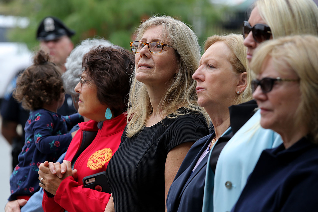 . Fitchburg City Councilors Marisa Fleming, Beth Walsh and Sam Squailia listen to the speakers at the 9-11 ceremony held at the North Street station house Tuesday, September 11, 2018. SENTINEL & ENTERPRISE/JOHN LOVE