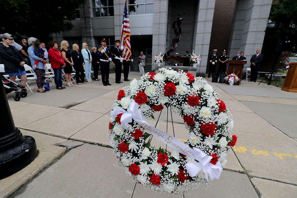 . A Wreath waits to be placed at the new 9-11 monument at the North Street Fire Station on Tuesday, September 11, 2018 during Fitchburg\'s 9-11 observances. SENTINEL & ENTERPRISE/JOHN LOVE