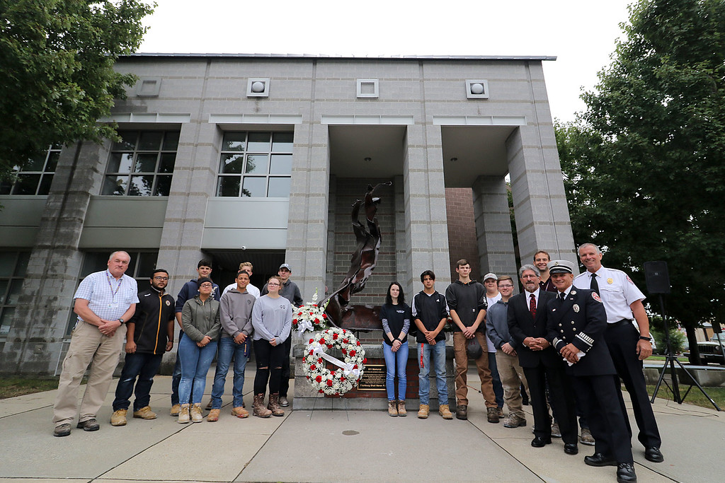 . Everyone that had a hand in getting this monument built at the Fitchburg North Street Fire Station pose for a picture after the 9-11 ceremony on Tuesday, September 11, 2018