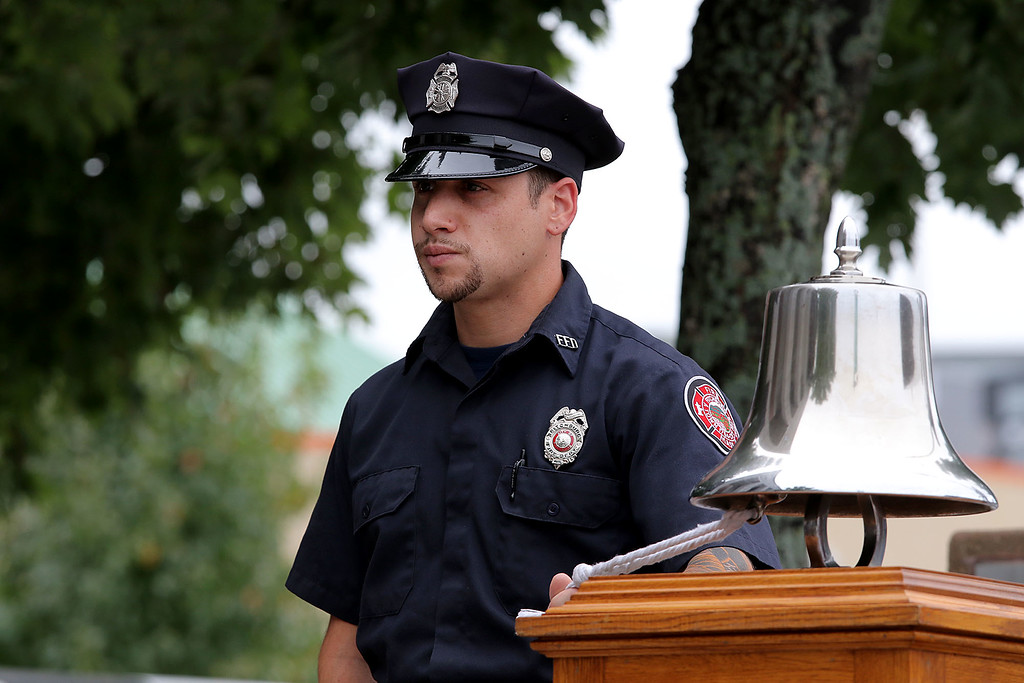 . Fitchburg Firefighter Anthony Liberatore rings the fire bell at the 9-11 ceremony held at the North Street station house Tuesday, September 11, 2018. SENTINEL & ENTERPRISE/JOHN LOVE