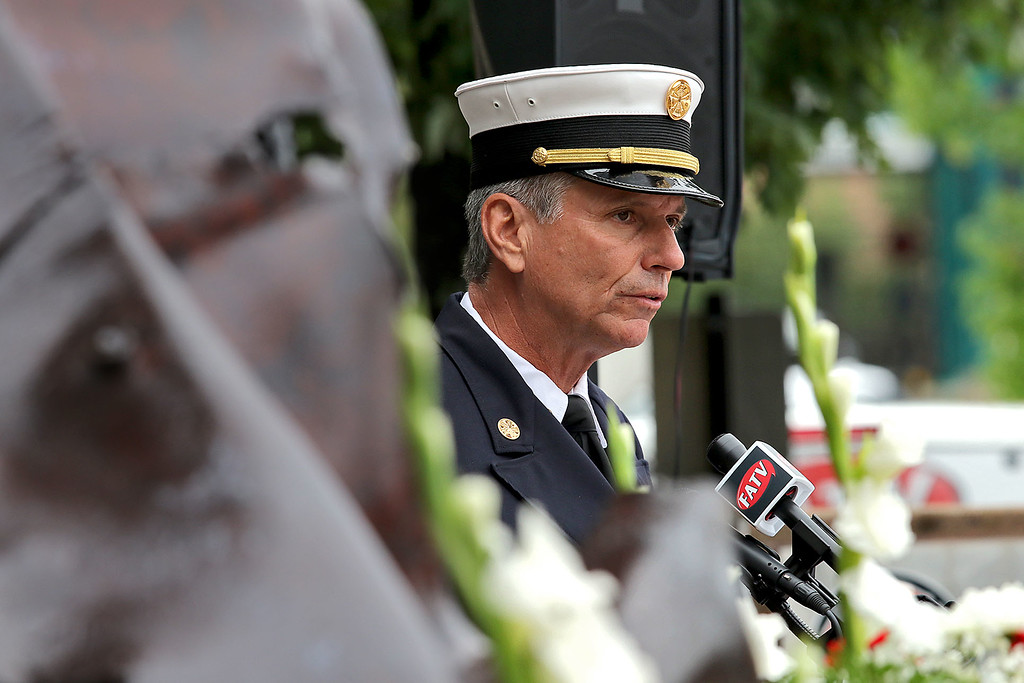 . Fitchburg Fire Chief Kevin Roy addresses the crowd at the 9-11 ceremony held at the North Street station house Tuesday, September 11, 2018. SENTINEL & ENTERPRISE/JOHN LOVE