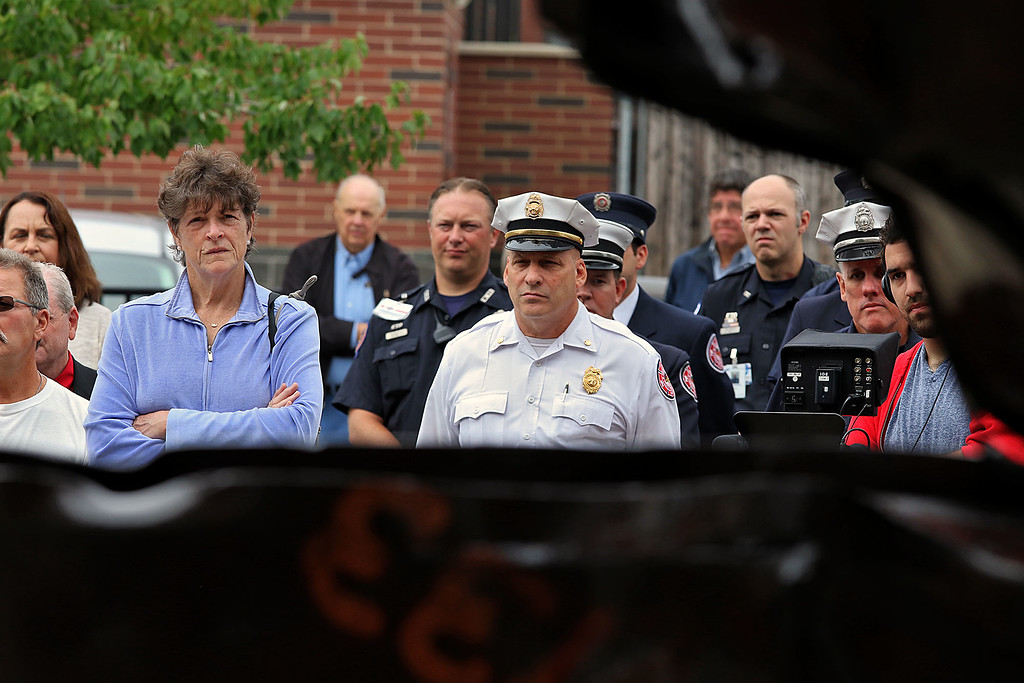 . Mary Alice Lavelle and Fitchburg Deputy Fire Chief Tom Dateo Listen to the speakers at the 9-11 ceremony held at the North Street station house Tuesday, September 11, 2018. SENTINEL & ENTERPRISE/JOHN LOVE