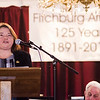 Fitchburg residents and local dignitaries gathered to celebrate the 125th anniversary of the Fitchburg Armory, now the Senior Center, on Wednesday evening. Susan Navarre, of the Historical Society, speaks about the history of the building during the event. SENTINEL & ENTERPRISE / Ashley Green