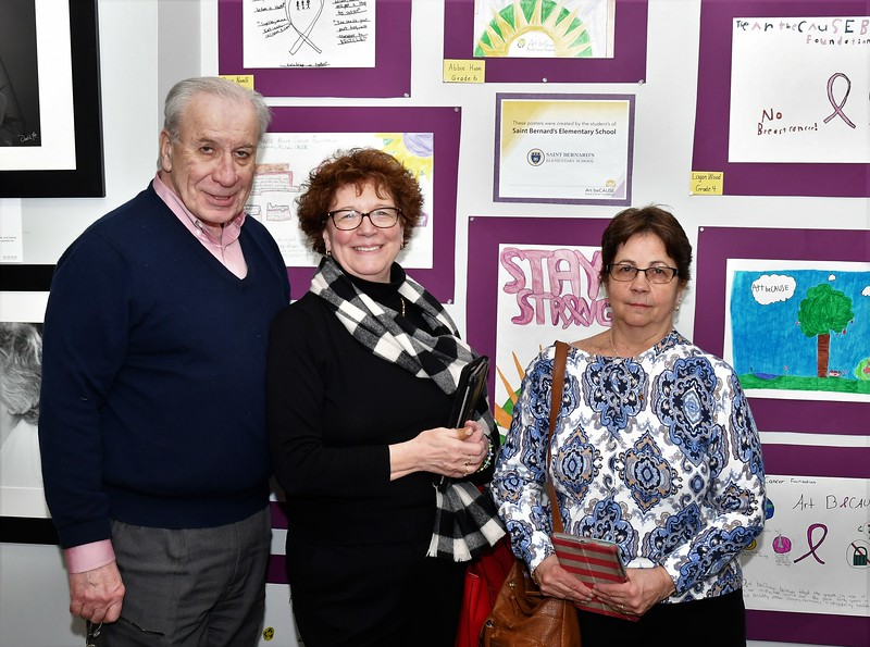 Attorney Jerry Paquette, Deborah Welch  pose with St. Bernard's art teacher, Marie Ingemie.  Marie's students  Artwork is a large part of the show. SENTINEL & ENTERPRISE/JIM FAY