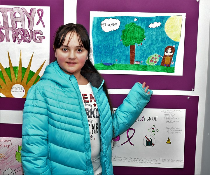 Cantrelle Ingemie-Collins, who is a home-schooled Fitchburg student, points out her artwork featured at the ArtBECAUSE Breast Cancer Foundation gallery opening on Sunday at the Fitchburg Art Museum. SENTINEL &  ENTERPRISE/JIM FAY