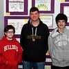 Owen Novelli , a student at St. Bernard's Elementary School is shown in front of his artwork with his father and brother, Joseph and Joseph Novelli. SENTINEL & ENTERPRISE/JIM FAY